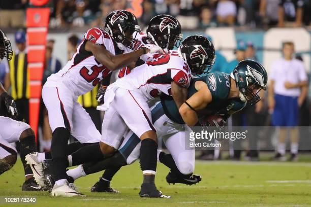 Zach Ertz of the Philadelphia Eagles is tackled by the Atlanta Falcons during the second half at Lincoln Financial Field on September 6 2018 in...