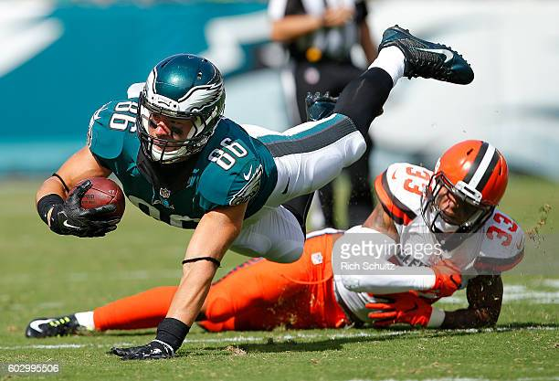 Zach Ertz of the Philadelphia Eagles is tripped up by Jordan Poyer of the Cleveland Browns after making a catch during the third quarter at Lincoln...