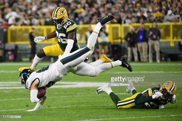 Zach Ertz of the Philadelphia Eagles is tripped up by Kevin King of the Green Bay Packers during the third quarter at Lambeau Field on September 26,...