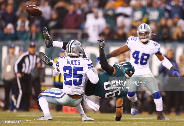 Zach Ertz of the Philadelphia Eagles is unable to catch a pass against Xavier Woods of the Dallas Cowboys during the first quarter in the game at...