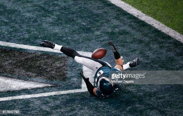 Zach Ertz of the Philadelphia Eagles juggles the ball in the end zone for an 11yard touchdown during the game against the New England Patriots in...