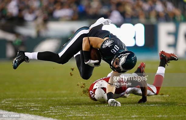 Zach Ertz of the Philadelphia Eagles makes a catch and is knocked out of bounds by Deone Bucannon of the Arizona Cardinals in the second quarter at...