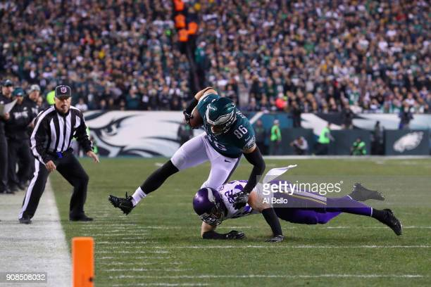 Zach Ertz of the Philadelphia Eagles makes a catch under pressure from Harrison Smith of the Minnesota Vikings during the second quarter in the NFC...