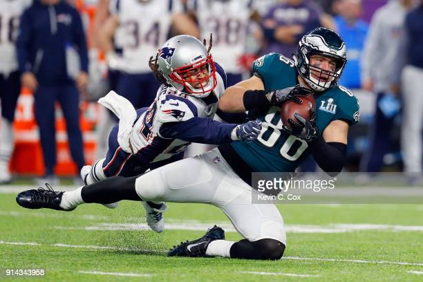 Zach Ertz of the Philadelphia Eagles makes a catch under pressure from Stephon Gilmore of the New England Patriots during the fourth quarter in Super...