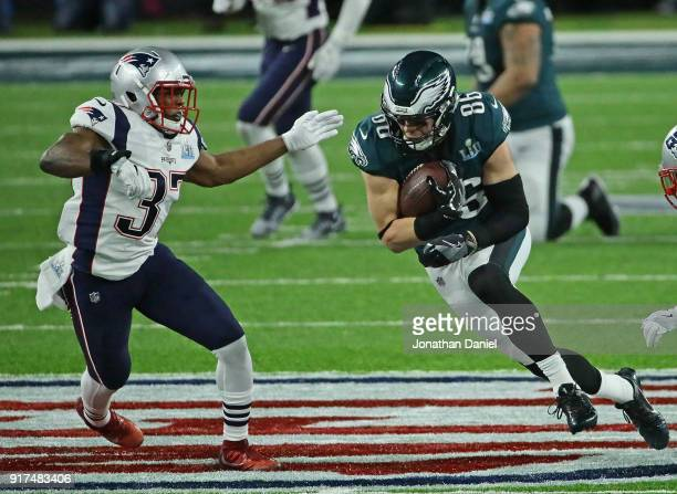 Zach Ertz of the Philadelphia Eagles runs after a catch chased by Jordan Richards of the New England Patriots during Super Bowl Lll at US Bank...