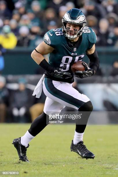 Zach Ertz of the Philadelphia Eagles runs with the ball in the first quarter against the Atlanta Falcons during the NFC Divisional Playoff game game...