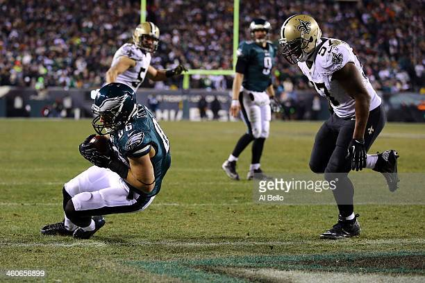 Zach Ertz of the Philadelphia Eagles scores a 3 yard touchdown pass from Nick Foles in the fourth quarter against the New Orleans Saints to take the...