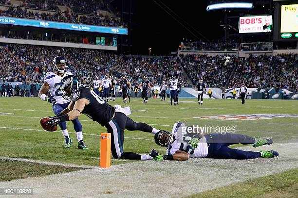 Zach Ertz of the Philadelphia Eagles scores a touchdown against KJ Wright of the Seattle Seahawks during the third quarter of the game at Lincoln...