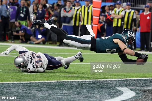 Zach Ertz of the Philadelphia Eagles scores an 11yard fourth quarter touchdown past Devin McCourty of the New England Patriots in Super Bowl LII at...