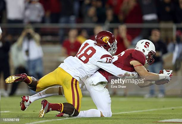 Zach Ertz of the Stanford Cardinal gets past Dion Bailey of the USC Trojans to score the winning touchdown at Stanford Stadium on September 15, 2012...