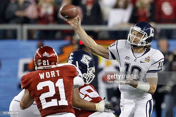Zach Frazer of the Connecticut Huskies throws the ball in the first half against the Oklahoma Sooners in the Tostitos Fiesta Bowl at the Universtity...