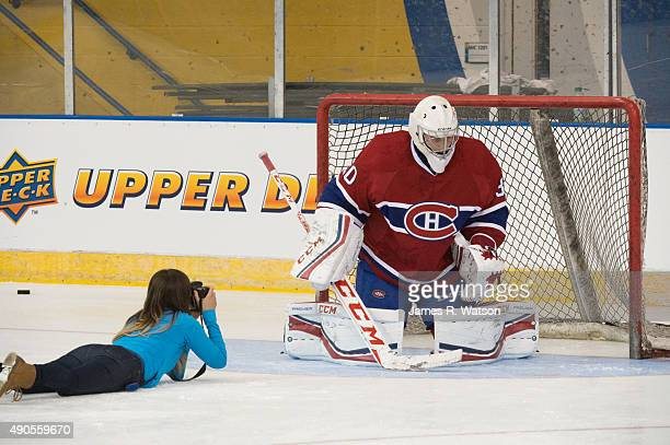 Zach Fucale of the Montreal Canadiens crouches for a photo by an Upper Deck photographer at the 2015 NHLPA Rookie Showcase at Mattamy Athletic Centre...