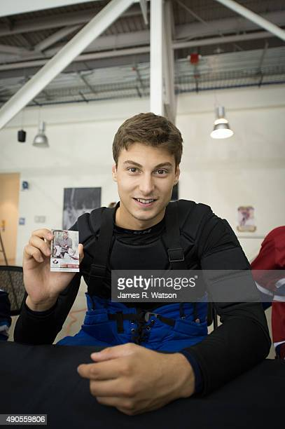Zach Fucale of the Montreal Canadiens discovers one of his own Upper Deck trading cards at the 2015 NHLPA Rookie Showcase at Mattamy Athletic Centre...