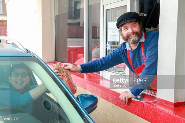 Zach Galifianakis serves customers during the FYC event for FX's 'Baskets' at Arby's on May 29 2018 in Los Angeles California