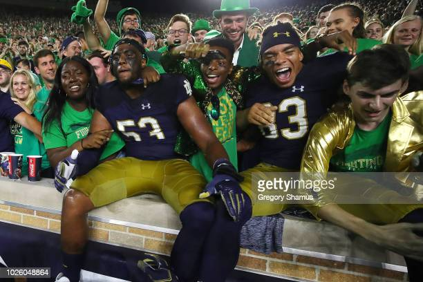 Zach Gentry and Khalid Kareem of the Notre Dame Fighting Irish celebrate a 24-17 win over the Michigan Wolverines at Notre Dame Stadium on September...