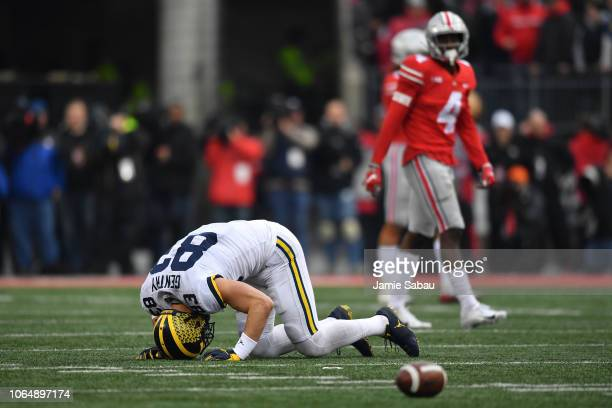 Zach Gentry of the Michigan Wolverines lies on the field after being injured while trying to make a reception in the third quarter against the Ohio...