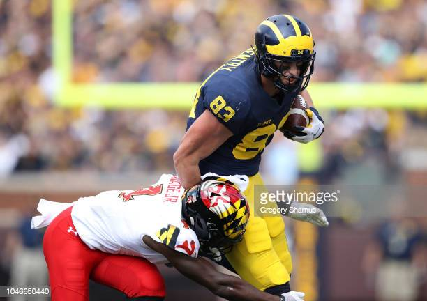 Zach Gentry of the Michigan Wolverines tries to avoid the tackle of Darnell Savage Jr #4 of the Maryland Terrapins during the first half on October 6...