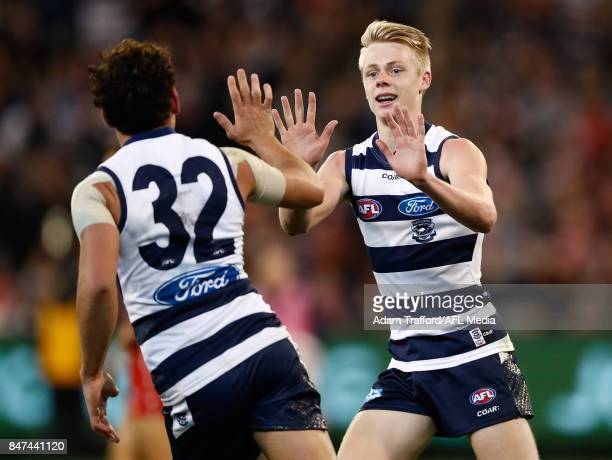 Zach Guthrie of the Cats celebrates with Steven Motlop of the Cats during the 2017 AFL Second Semi Final match between the Geelong Cats and the...