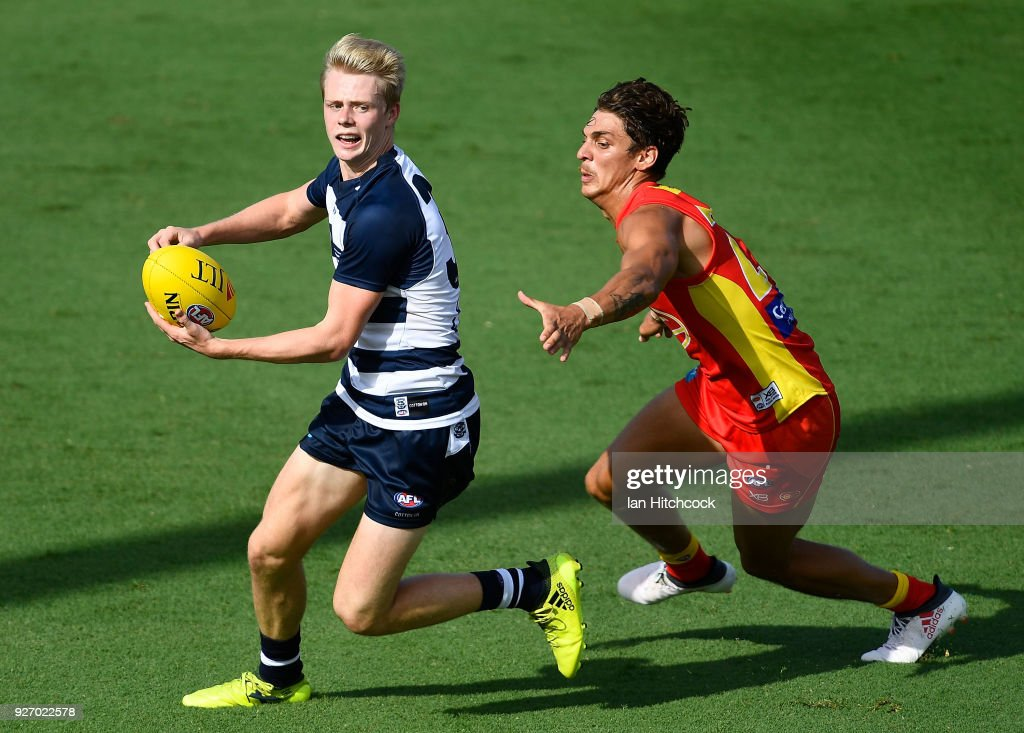 Zach Guthrie of the Cats looks to get away from of Sean Lemmens of the Suns during the AFL JLT Community Series match between the Geelong Cats and the Gold Coast Suns at Riverway Stadium on March 4, 2018 in Townsville, Australia.