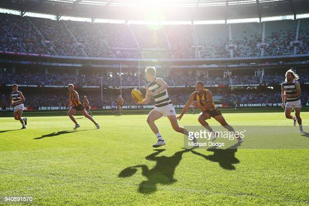 Zach Guthrie of the Cats looks upfield from Jarman Impey of the Hawks during the round two AFL match between the Geelong Cats and the Hawthorn Hawks...