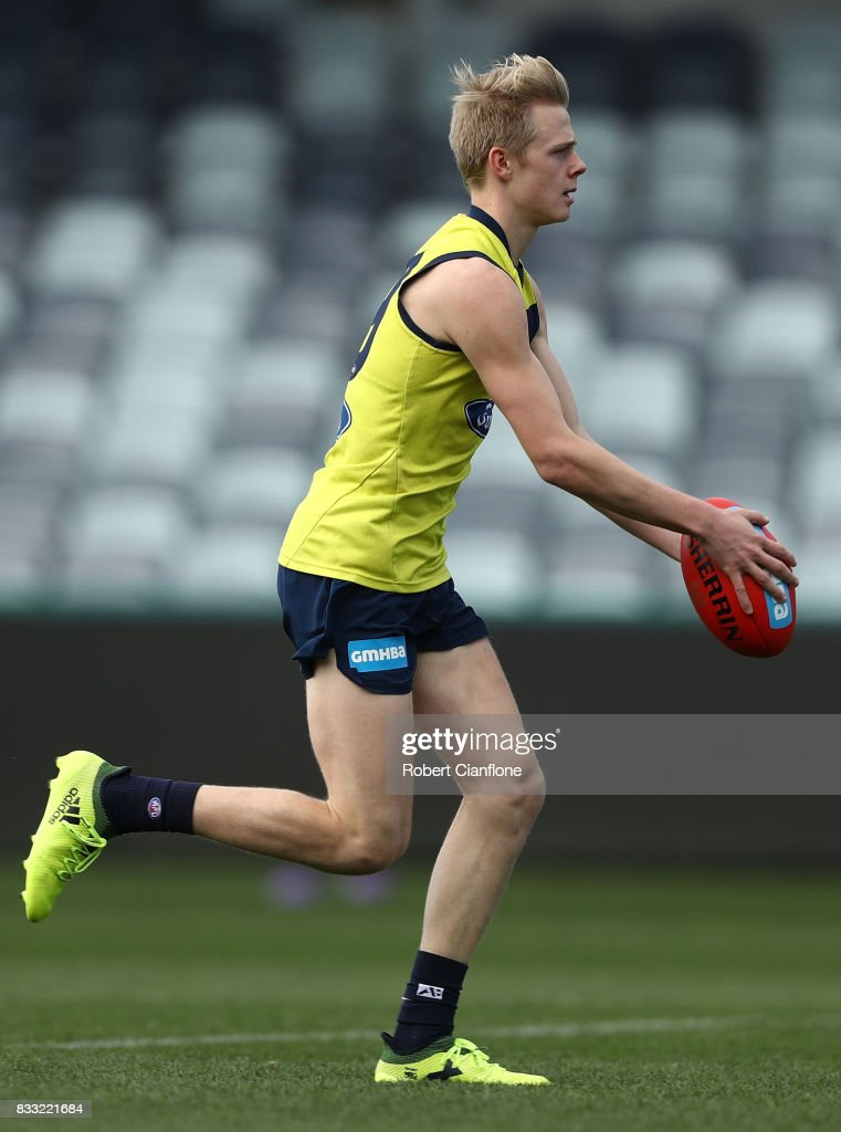 Zach Guthrie of the Cats runs with the ball during a Geelong Cats AFL training session at Simonds Stadium on August 17, 2017 in Geelong, Australia.