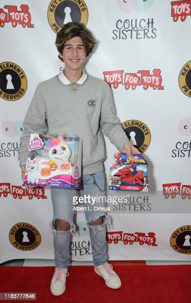 Zach Hennessey attends The Couch Sisters 1st Annual Toys For Tots Toy Drive held onNovember 20 2019 in Glendale California