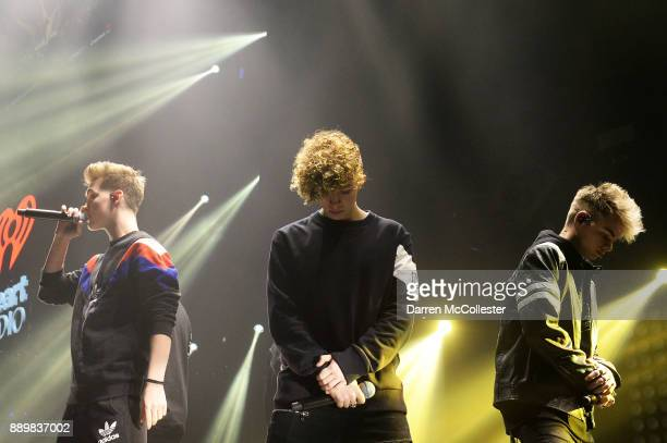 Zach Herron Jack Avery and Corbyn Besson of Why Don't We perform onstage during KISS 108's Jingle Ball 2017 presented by Capital One at TD Garden on...