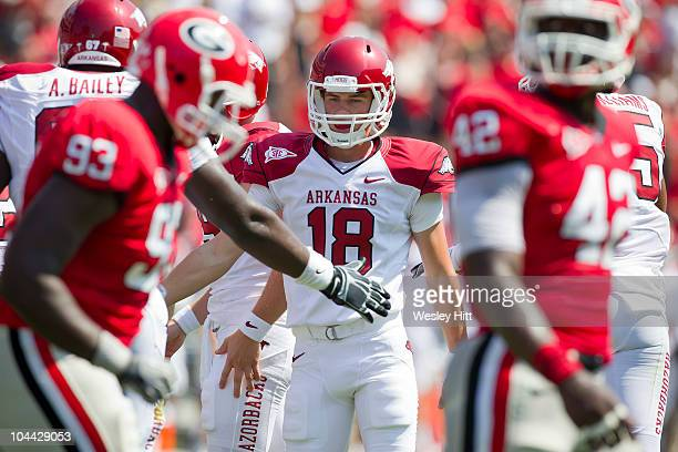 Zach Hocker of the Arkansas Razorbacks is congratulated after kicking a extra point against the Georgia Bulldogs at Sanford Stadium on September 18...