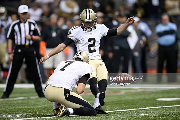 Zach Hocker of the New Orleans Saints kicks a field goal against the Dallas Cowboys at MercedesBenz Superdome on October 4 2015 in New Orleans...