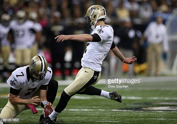 Zach Hocker of the New Orleans Saints kicks off during the third quarter against the Dallas Cowboys at MercedesBenz Superdome on October 4 2015 in...