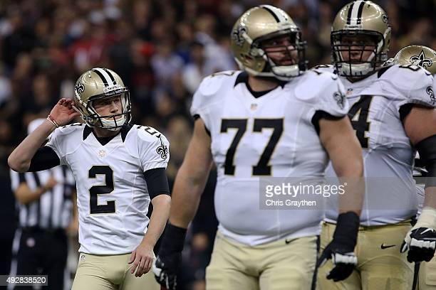 Zach Hocker of the New Orleans Saints reacts to a missed field goal during the second quarter of a game against the Atlanta Falcons at the...