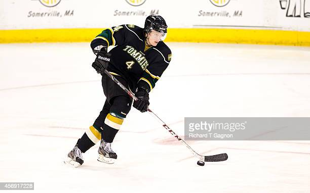Zach Hodder of the St. Thomas University Tommies controls the puck against the Massachusetts Lowell River Hawks during NCAA exhibition hockey at the...