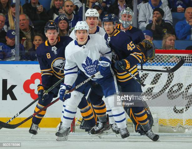 Zach Hyman and Patrick Marleau of the Toronto Maple Leafs are defended by Casey Nelson Brendan Guhle and Robin Lehner of the Buffalo Sabres during an...