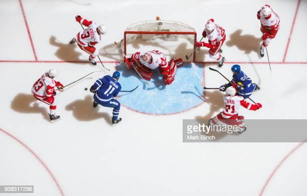 Zach Hyman and William Nylander of the Toronto Maple Leafs goes to the net against Darren Helm Dylan Larkin Anthony Mantha Danny DeKeyser Nick Jensen...
