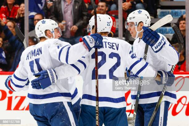 Zach Hyman Nikita Zaitsev and teammates of the Toronto Maple Leafs in an NHL game against the Calgary Flames at the Scotiabank Saddledome on November...