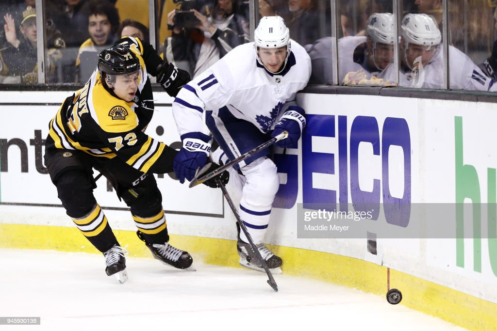 Zach Hyman #11 of the Toronto Maple Leafs and Charlie McAvoy #73 of the Boston Bruins battle for control of the puck during the second period of Game One of the Eastern Conference First Round during the 2018 NHL Stanley Cup Playoffs at TD Garden on April 12, 2018 in Boston, Massachusetts.