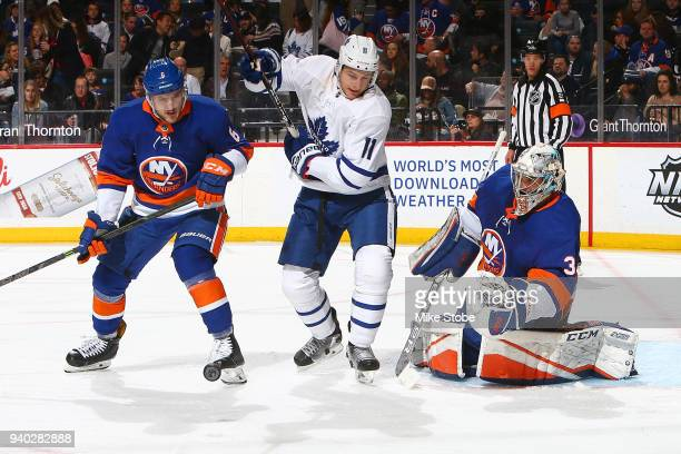 Zach Hyman of the Toronto Maple Leafs attempts to screen Christopher Gibson of the New York Islanders at Barclays Center on March 30 2018 in New York...