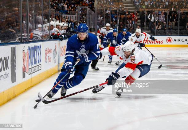 Zach Hyman of the Toronto Maple Leafs battles for the puck against Aaron Ekblad of the Florida Panthers during the third period at the Scotiabank...
