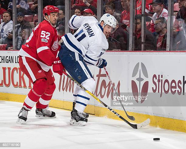 Zach Hyman of the Toronto Maple Leafs battles for the puck along the boards with Jonathan Ericsson of the Detroit Red Wings during an NHL game at Joe...