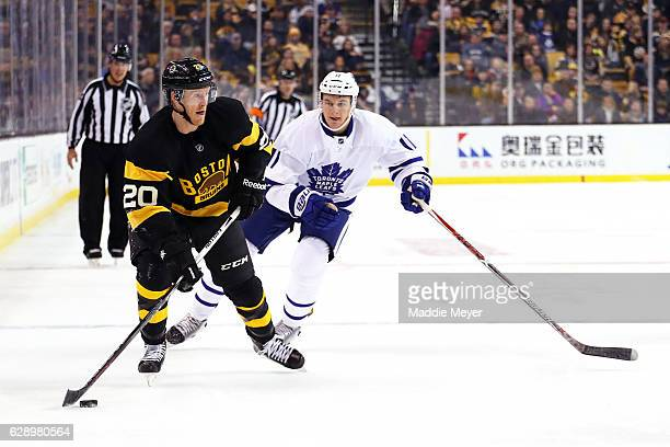Zach Hyman of the Toronto Maple Leafs defends Riley Nash of the Boston Bruins during the first period at TD Garden on December 10 2016 in Boston...