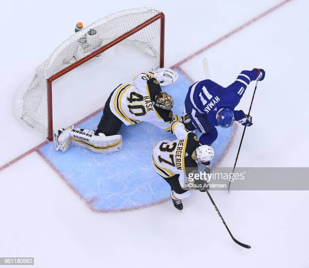 Zach Hyman of the Toronto Maple Leafs gets set to score a goal on Tuukka Rask of the Boston Bruins that is eventually called back for interference in...