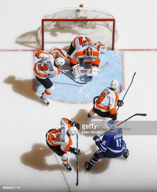 Zach Hyman of the Toronto Maple Leafs goes to the net against Brian Elliott Wayne Simmonds Robert Hagg and Radko Gudas of the Philadelphia Flyers...