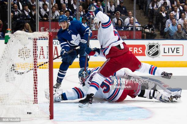 Zach Hyman of the Toronto Maple Leafs scores on Henrik Lundqvist of the New York Rangers as Tony DeAngelo of the New York Rangers attempts to break...