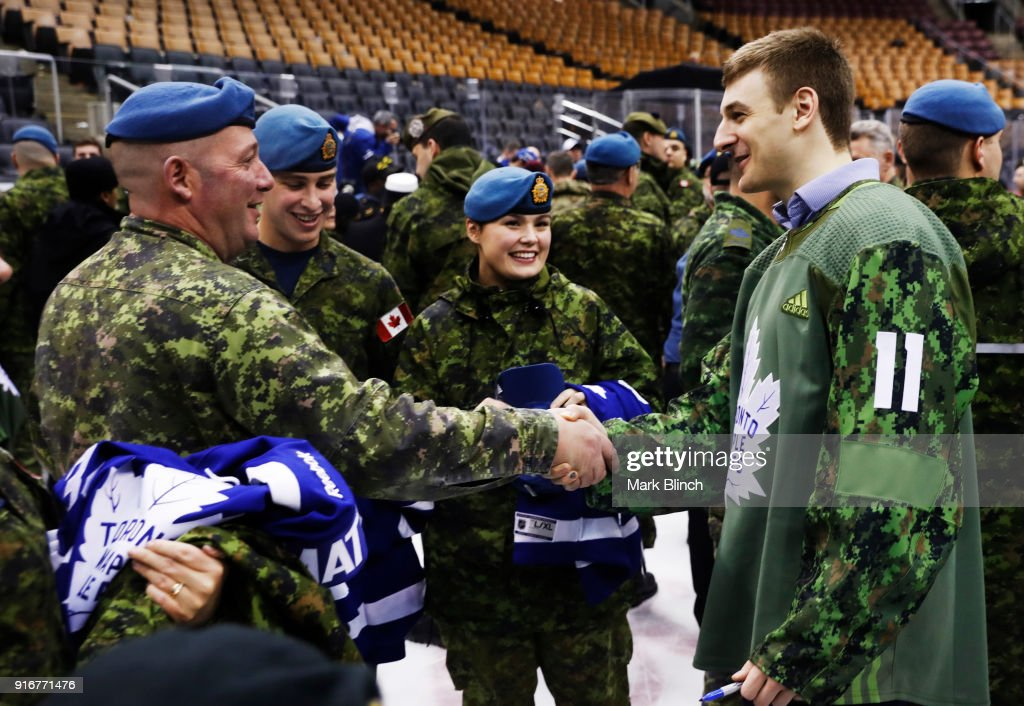 Zach Hyman #11 of the Toronto Maple Leafs shakes hands with members of the Canadian Armed Forces during Military Night at the Air Canada Centre on February 10, 2018 in Toronto, Ontario, Canada.