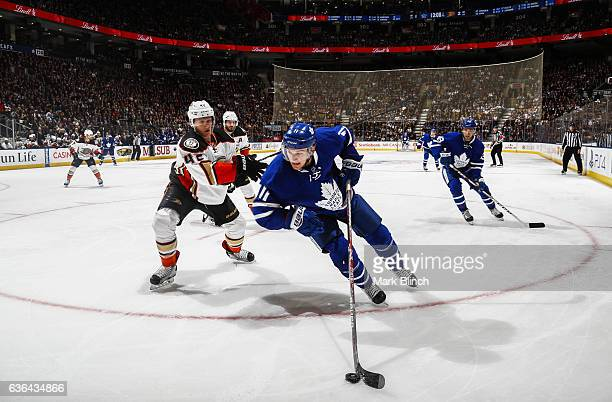 Zach Hyman of the Toronto Maple Leafs skates against Sami Vatanen of the Anaheim Ducksduring the third period at the Air Canada Centre on December 19...