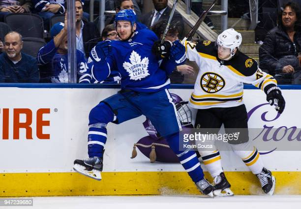 Zach Hyman of the Toronto Maple Leafs skates against Torey Krug of the Boston Bruins in Game Three of the Eastern Conference First Round during the...