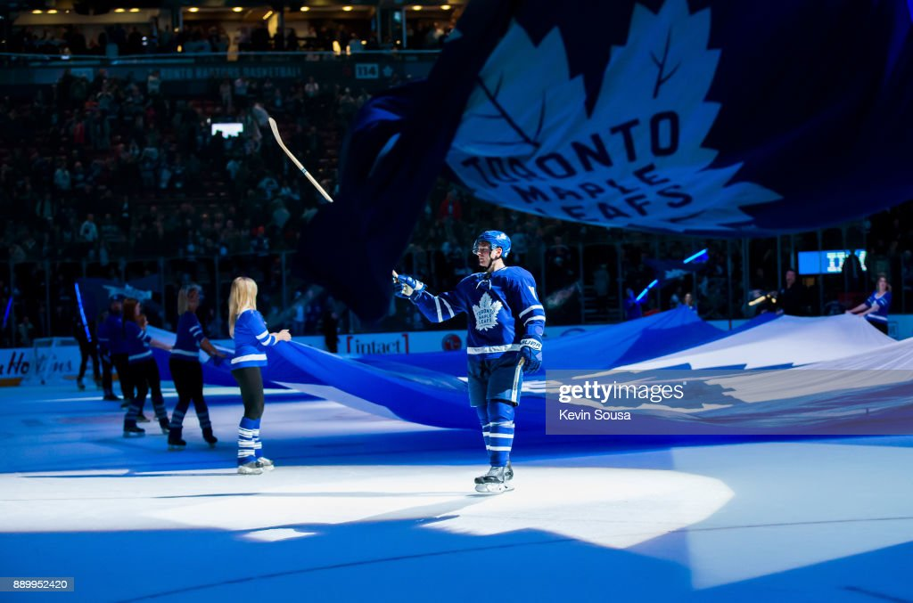 Zach Hyman #11 of the Toronto Maple Leafs skates to pass a stick to a fan after being named one of the games three stars after the Leafs defeated the Edmonton Oilers at the Air Canada Centre on December 10, 2017 in Toronto, Ontario, Canada.