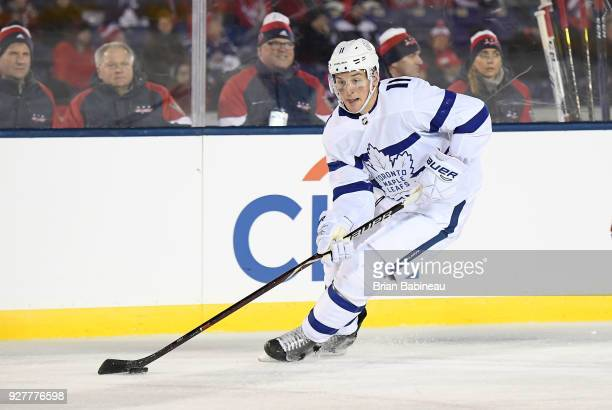 Zach Hyman of the Toronto Maple Leafs skates with the puck during the 2018 Coors Light NHL Stadium Series game between the Toronto Maple Leafs and...