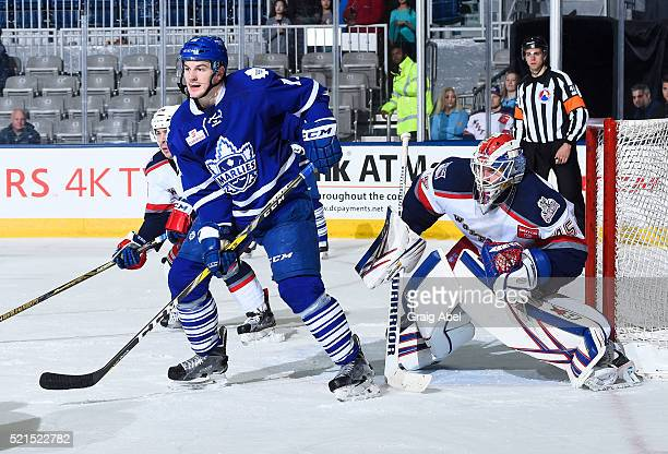 Zach Hyman of the Toronto Marlies puts a screen on Magnus Hellberg of the Hartford Wolf Pack during game action on April 13 2016 at the Ricoh...
