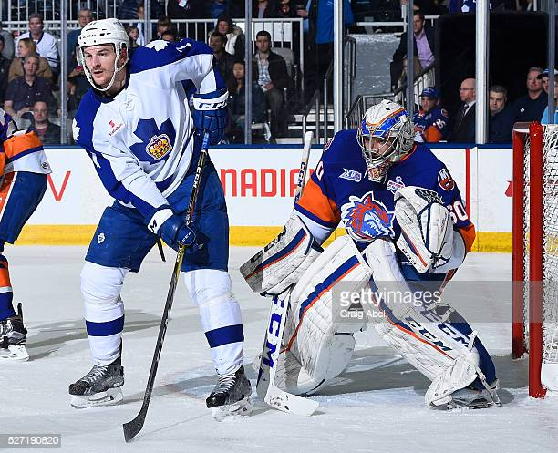 Zach Hyman of the Toronto Marlies puts a screens on Christopher Gibson of the Bridgeport Sound Tigers during AHL playoff game action on April 28 at...